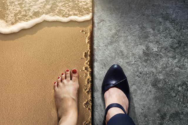 One foot on a beach and another in a high-heeled shoe