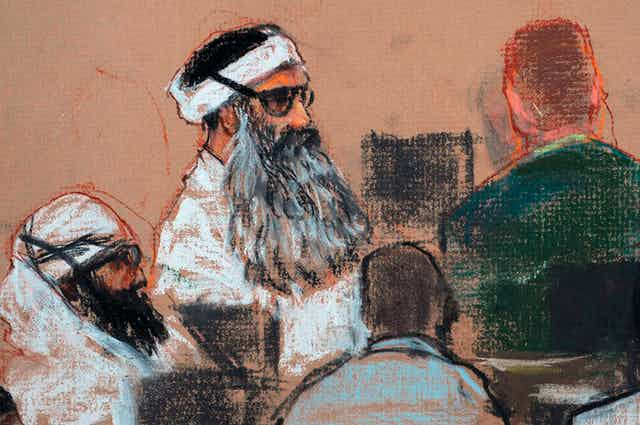 A court drawing depicting Khalid Sheikh Mohammed and co conspirators at a pretrial hearing.