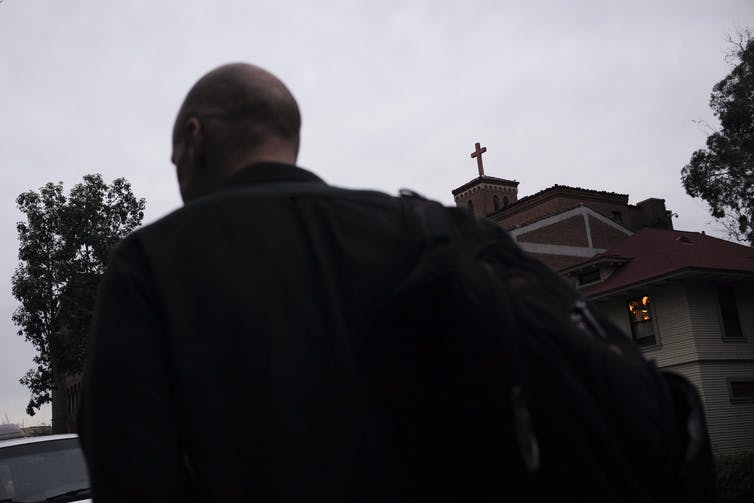 Humanist chaplain Bart Campolo walks past the United University Church at the University of Southern California in 2015.