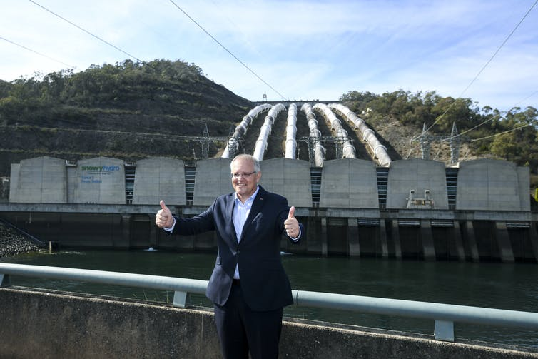 Man gives thumbs up at hydro project
