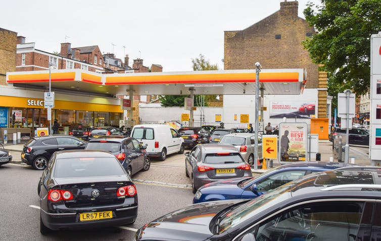 Long queues of cars waiting to pull into a Shell petrol station.