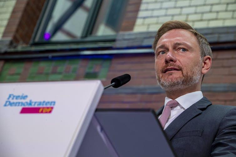 FDP leader Christian Lindner holding a press conference.