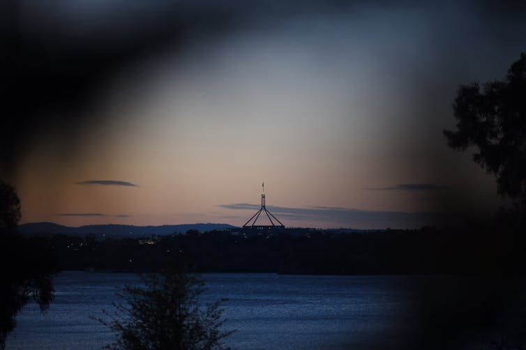 Federal parliament at sunset.