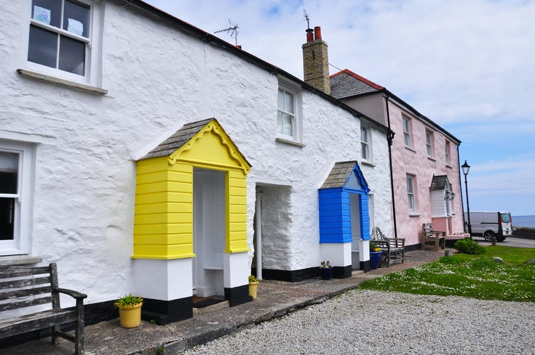 Two seaside holiday rental properties, with colourful front porches