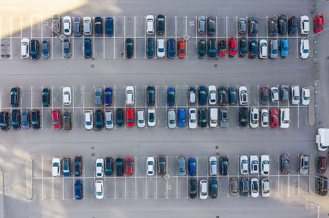 aerial view of cars parked in a car park