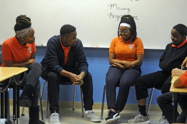 Students participate in an activity about mental health and suicide prevention at Uplift Hampton Preparatory School in Dallas.