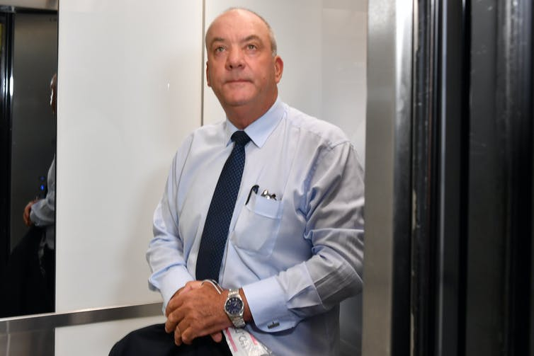 Former MP Daryl Maguire, with whom Berejiklian had a relationship, stands in a lift at the Independent Commission Against Corruption.