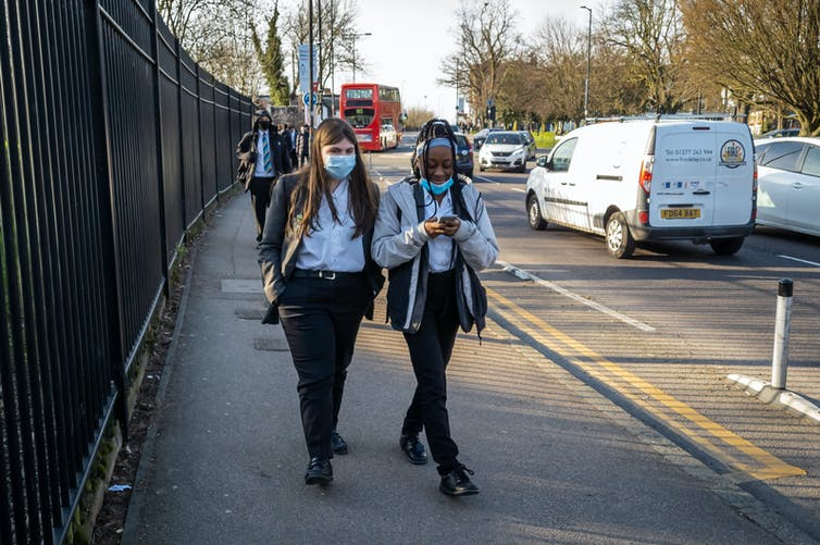 Two pin-up girls leaving school