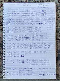 Latin and enciphered text written in notebook.