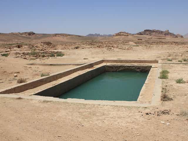 A rectangular pool carved into an arid landscape.