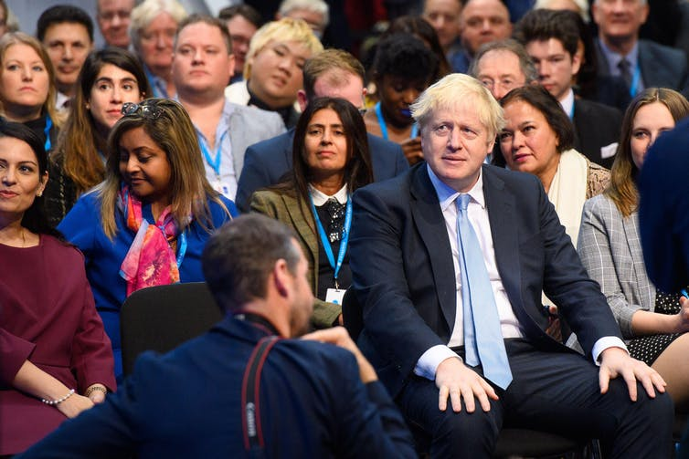 The audience at the Conservative party conference, with Boris Johnson seated on the front row