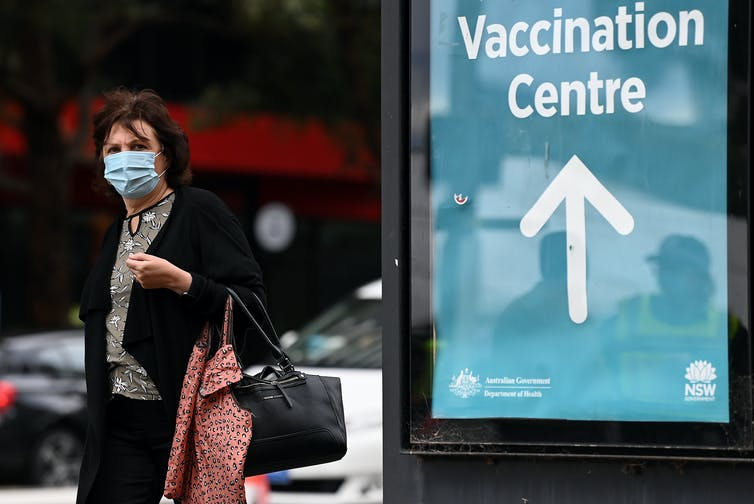 Woman leaves vaccination center