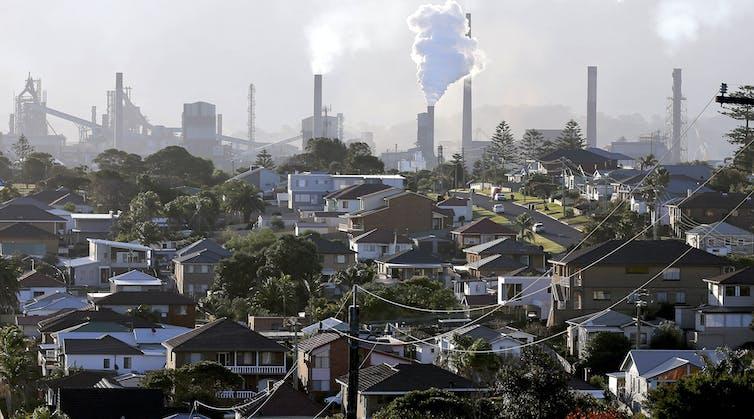 suburban scene with smoke stacks