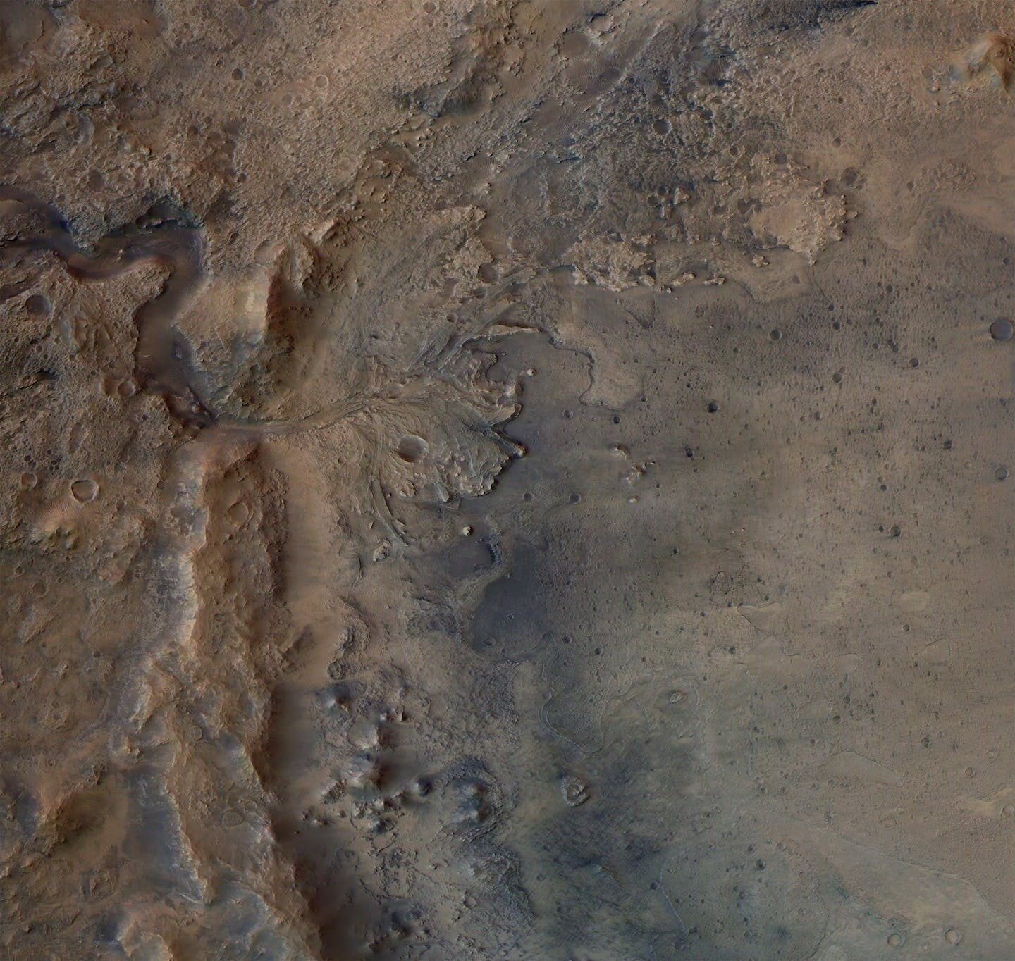 A satellite image showing a delta shaped rock formation on the surface of Mars.