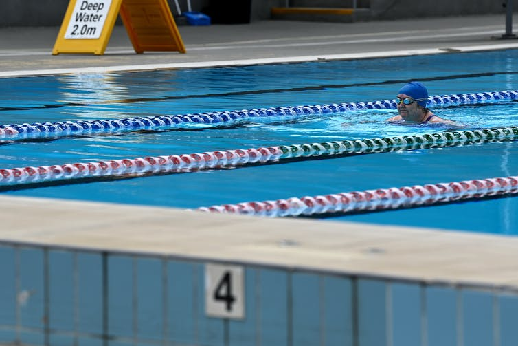 A woman swims in a pool