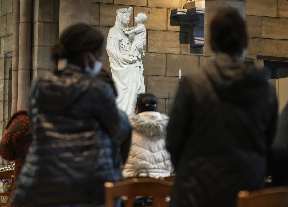 People pray for victims of sex abuse during a special service at the Catholic church Sainte Jeanne d'Arc de la Mutualité in Saint Denis, outside Paris, Oct. 5, 2021.