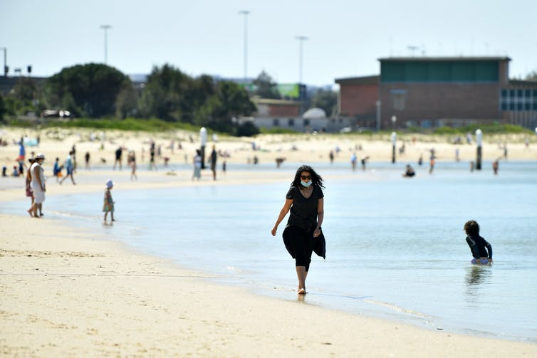 Woman walking along a beach