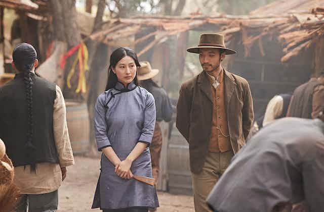 Production image: a Chinese man and woman walk together