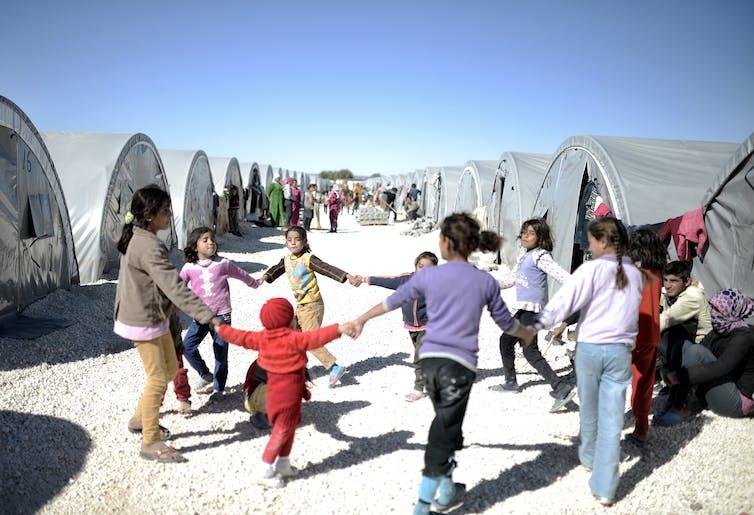 Syrian refuge children playing in refugee camp in Turkey