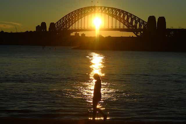 Woman walking by herself around Sydney Harbur