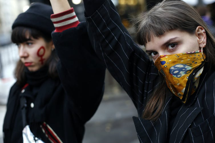 Two women at an anti-domestic violence march.
