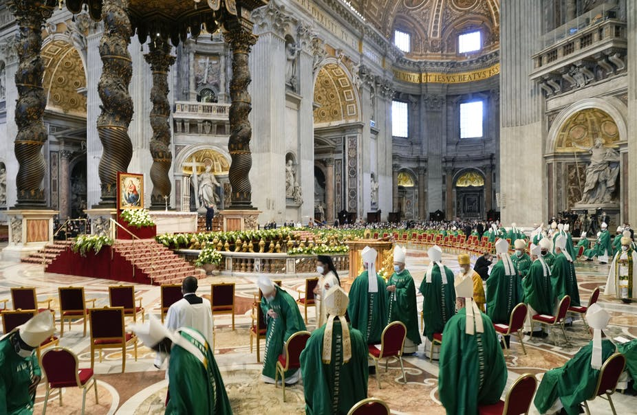 Bishops dressed in green and white wait for the arrival of Pope Francis at a mass to open the synod in St. Peter's Basilica at the Vatican on Oct. 10, 2021.