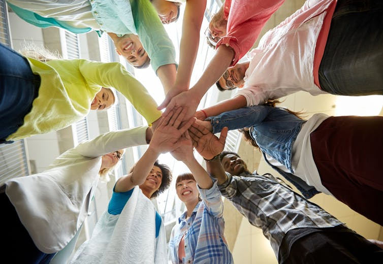 School kids holding hands