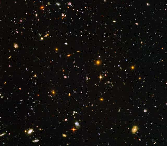 A picture of thousands of galaxies in space.