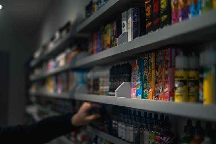 A shelf of e-liquids for vaping