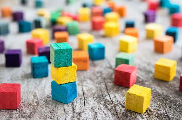 Multicoloured building blocks scattered around.