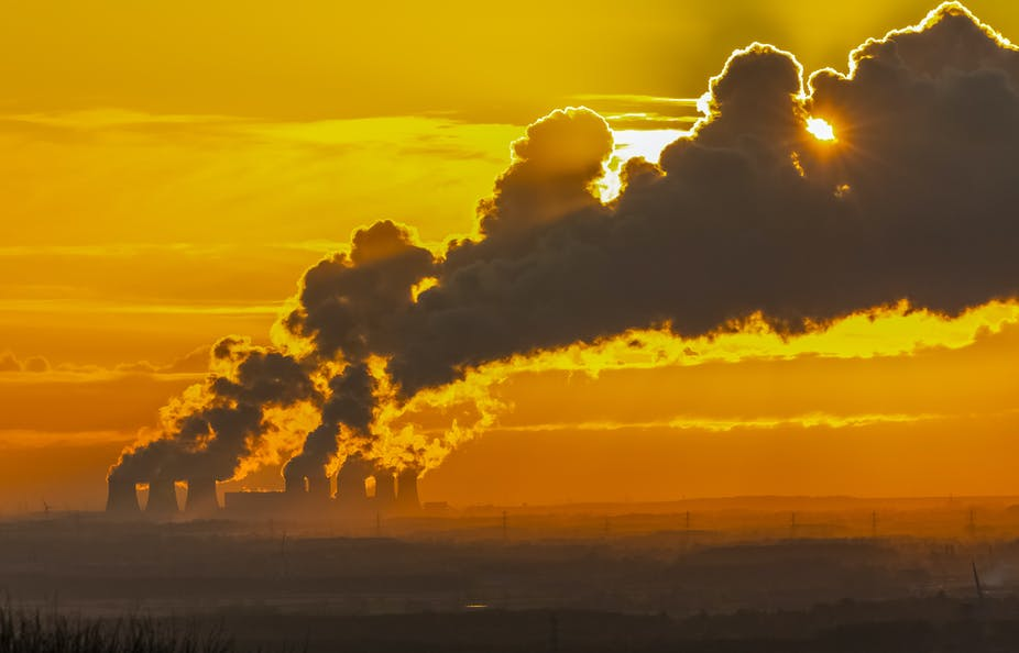 Steam from power station with sunset behind.