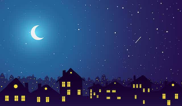 Illustration d'une ville éclairée par la Lune.