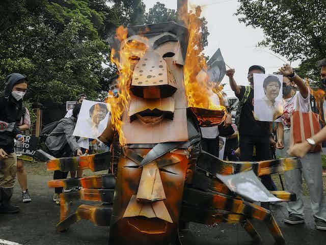 Protesters burn effigies of Duterte and Marcos Jr.