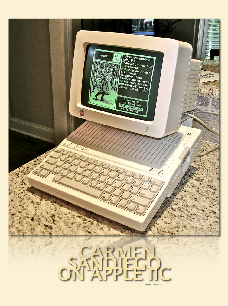 1980s computer with Carmen Sandiego on the screen.