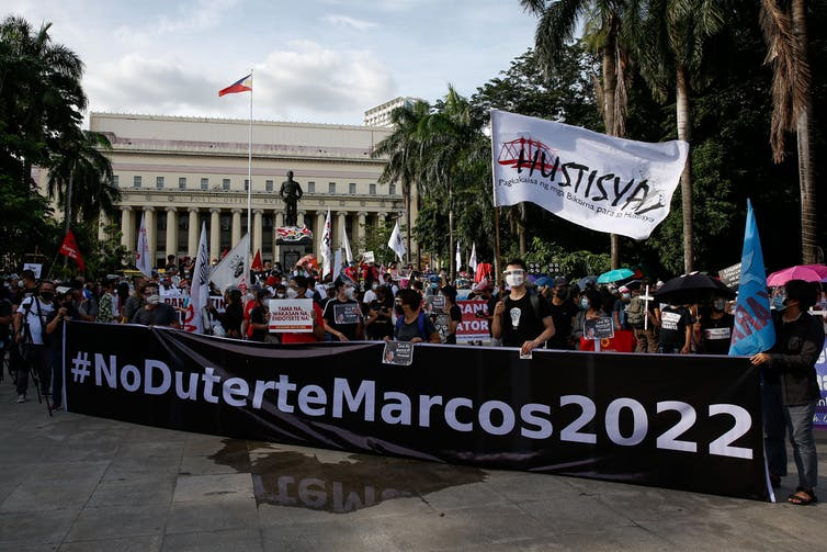 Activists protested against Marcos and Duterte.