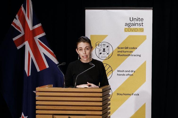 Jacinda Ardern speaking at a COVID-19 briefing