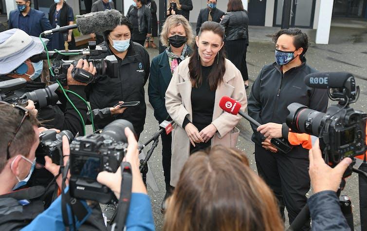 Jacinda Ardern talking to reporters outdoors