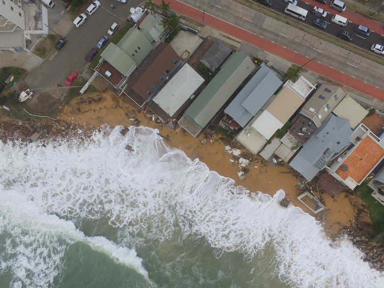 ocean rises up to homes