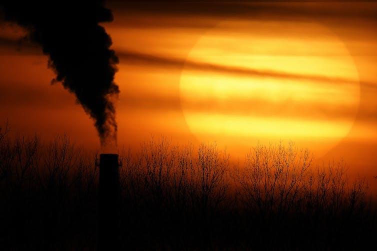 sunset and smoke stack