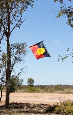 An Aboriginal flag flown in protest against mining at the Adani Bravus Carmichael mine site in the Galilee Basin, Central Queensland.