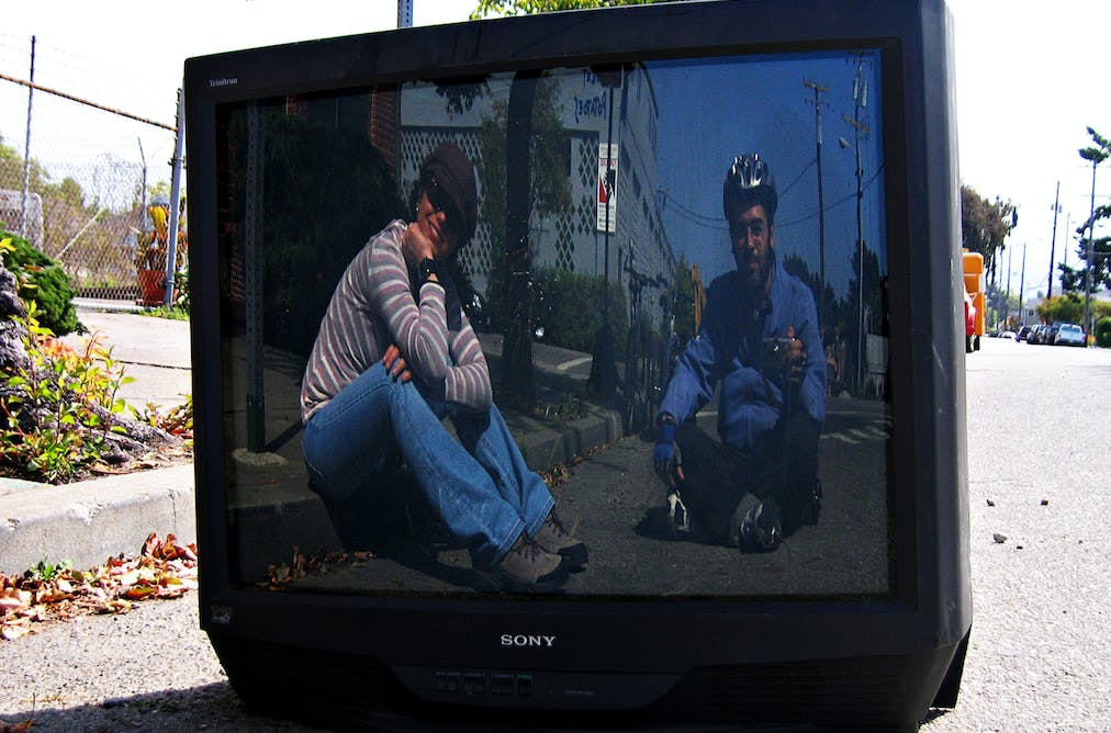 television essays Television (tv) is a telecommunication medium used for transmitting moving images in monochrome (black and white), or in colour, and in two or three dimensions and sound the term can refer to a television set, a television program (tv show), or the medium of television transmission.