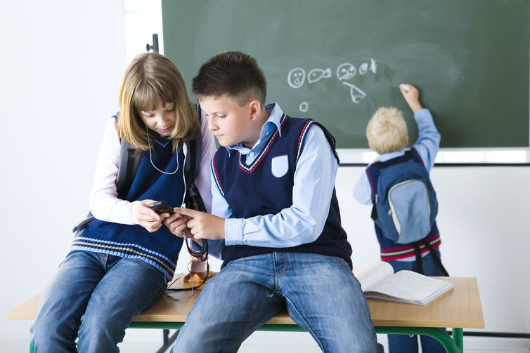 how smart is it to allow students to use mobile phones at school  lowest achieving kids gained the most from mobile phone bans children image via shutterstock com