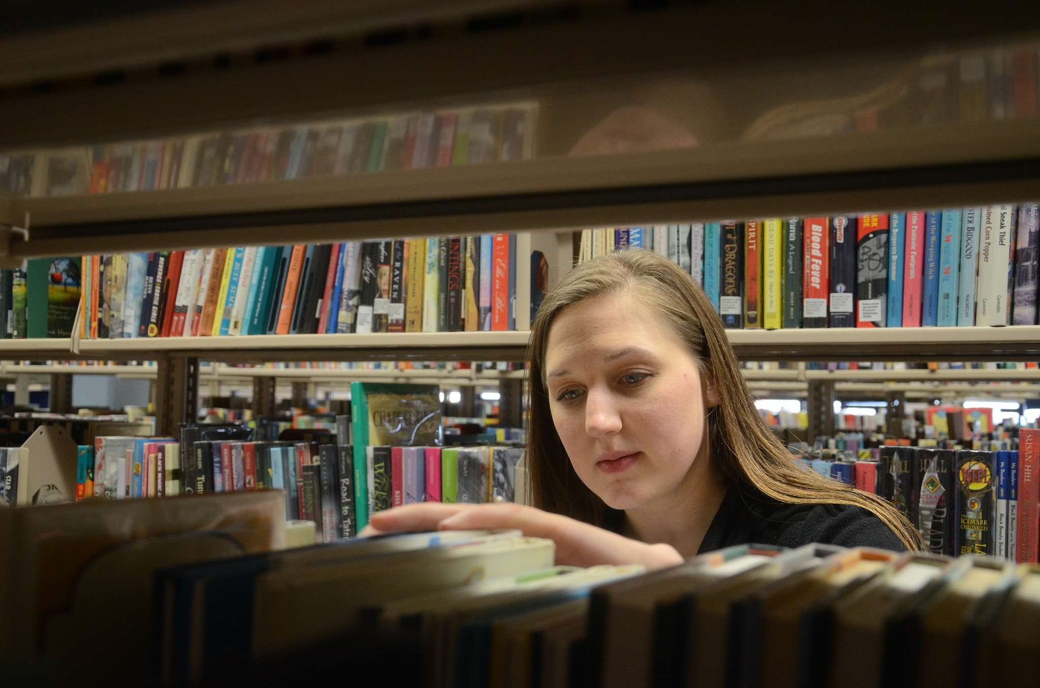 Turning a page: downsizing the campus book collections