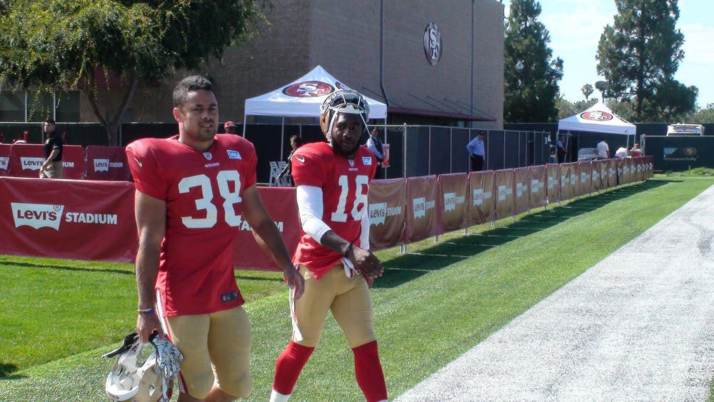 617945c56 Jarryd Hayne (left) in training for the San Francisco 49ers with wide  receiver DeAndrew White walk (right) at the team s practice field at Santa  Clara