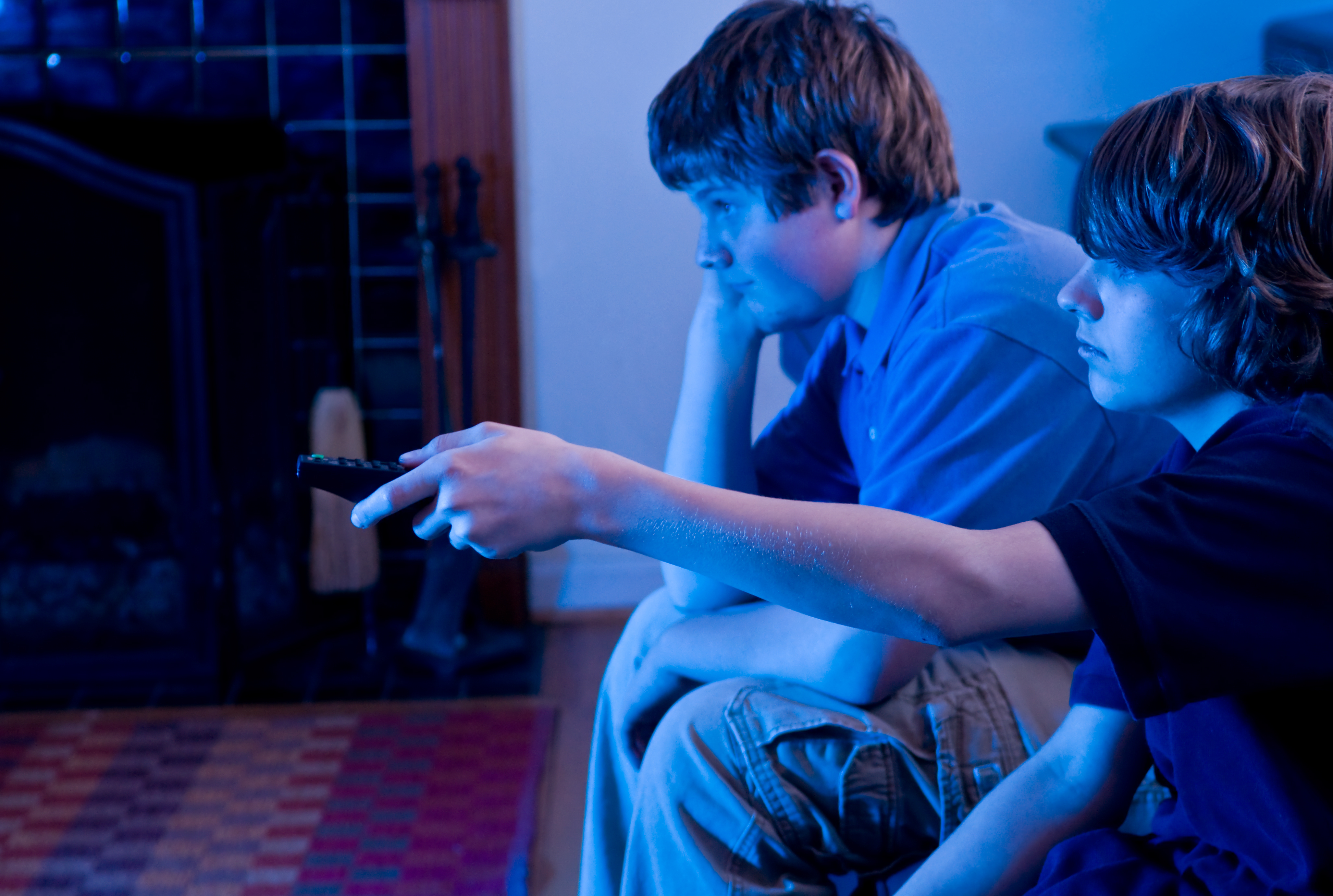kids watching tv at night. the original recommendations were made with tv shows and films in mind. \u0027watching tv\u0027 via www.shutterstock.com kids watching tv at night